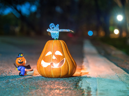 halloween pumpkin and candle light in the dark night Stock Photo