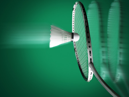badminton sport , racket with string and shuttlecock on green background, both racket and ball are in motion blur