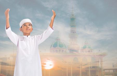 muslim child praying for Allah, muslim God on sky background