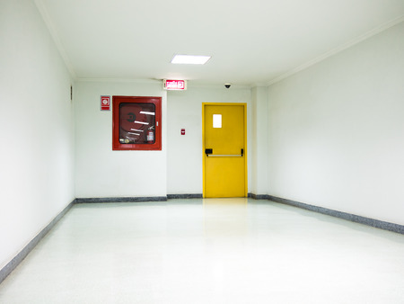 Building Emergency Exit with Exit Sign on door and Fire Extinguisher
