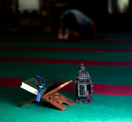 still life image of the Quran. The Quran literally meaning the recitation is the central religious text book of Islam, which Muslims believe to be the verbatim word of God or Allah