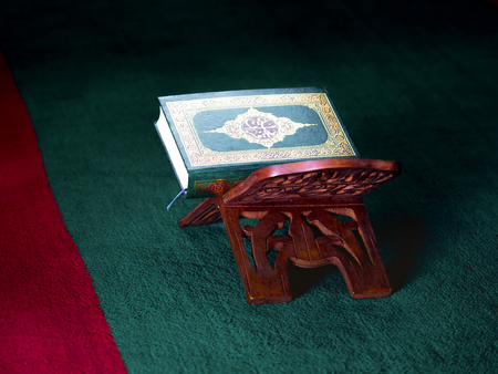 recitation: still life image of the Quran. The Quran literally meaning the recitation is the central religious text book of Islam, which Muslims believe to be the verbatim word of God or Allah