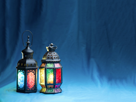 lighting with colors  on muslim styles lantern shining on cyan fabric background