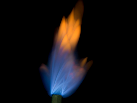 close up shot on flame, hot spot details of fire on black background,  flameability of butane gas for cook and heat concept.