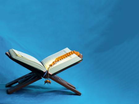 Quran or Kuran, the islamic holy book, in dark background