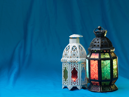 candle: lighting with colors  on muslim styles lantern shining on cyan fabric background