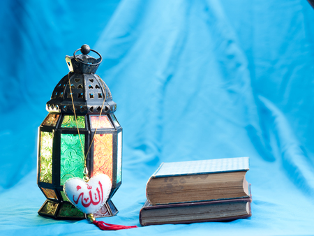 candle: lighting with colors on muslim styles lantern shining on arabic letter of the name of God  Allah in heart shape