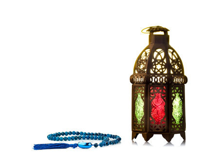 candle: Candle light lids on muslim styles lantern shining on floor with colorful vintage pattern on surface, use as greeting on ramadan kareem mubarak