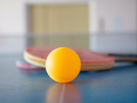 yellow table tennis ball on sport table for recreational player