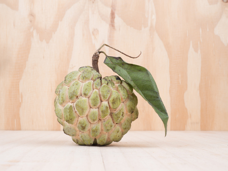 close up shot of custard apple, sweet fruits on wooden background,  vegetable for diet with nutrition ingredient concept. Stock Photo
