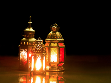 candle: Candle light lids on muslim styles lantern shining on the dark, use as greeting on ramadan kareem mubarak
