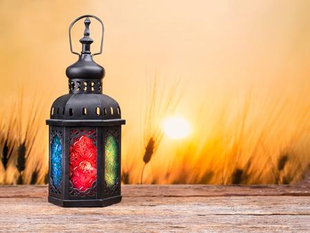 candle: Candle light lids on muslim styles lantern shining on arabic letter of the name of God  Allah in heart shape, use as greeting on ramadan kareem mubarak