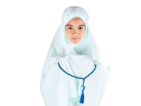 Muslim girl with fully traditional dress praying for Allah, Muslim God, on mosque in ramadan kareem night Stock Photo