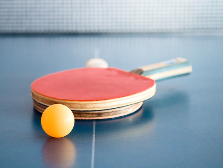 yellow pingpong ball on sport table for recreational player 스톡 콘텐츠
