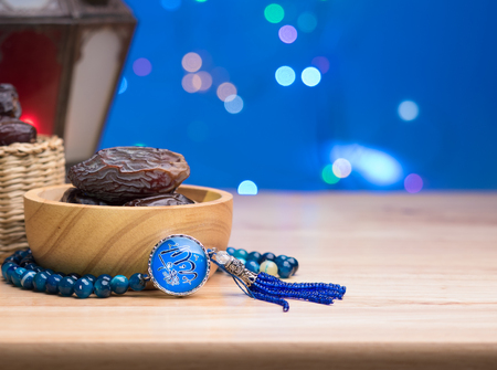 close up shot on rosary beeds with arabic text Allah on wooden background,  vegetable for diet with nutrition ingredient concept. Stok Fotoğraf
