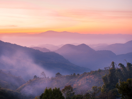 beautiful row of  mountains and hills in the evening with wonderful breathtaking sky cloud. 스톡 콘텐츠