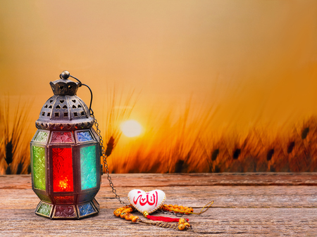 Candle light lids on muslim styles lantern shining on arabic letter of the name of God Allah in heart shape, use as greeting on ramadan kareem mubarak Stok Fotoğraf