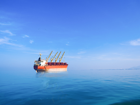 Big international cargo ship for industrial import and export transportation on the ocean
