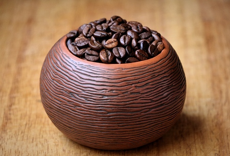 coffee beans in a ceramic bowl