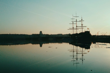 girders: Sailing-ship reflecting in water in twilights Stock Photo