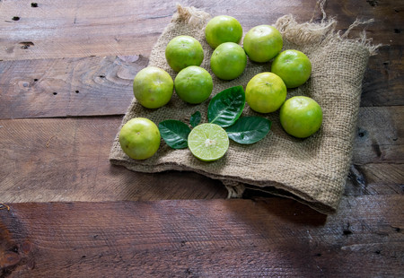 dissect: lemon dissect with leaves on wood
