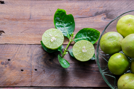dissect: Lemons with leaves on wood