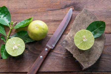 dissect: lemons with knife(focus lemon on block)