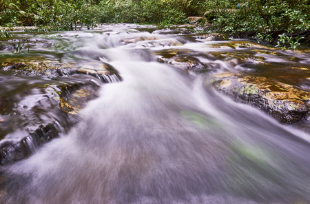 rocks water: Water flows over rocks in a river. Stock Photo