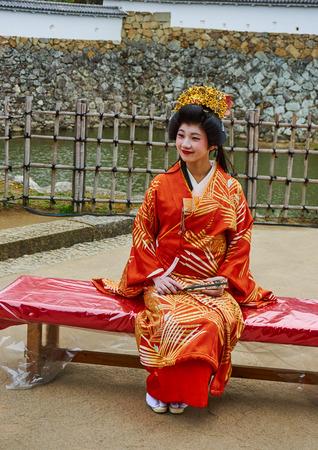 portait: HIMEJI, JAPAN - NOVEMBER 23: Japanese lady wearing traditional kimono in a Himeji castle, November 23, 2016 in Himeji, Japan. Editorial
