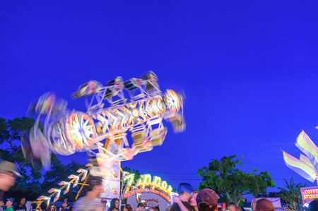 Zipper Swing Ride on the blue sky background