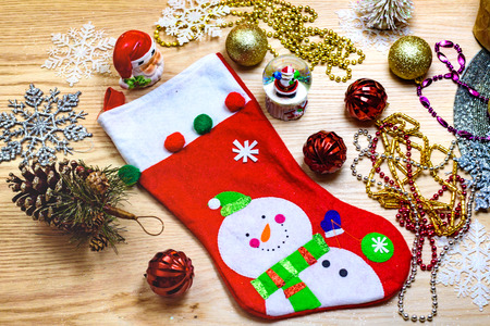 christmas sock: Christmas sock and ornaments on the wooden table