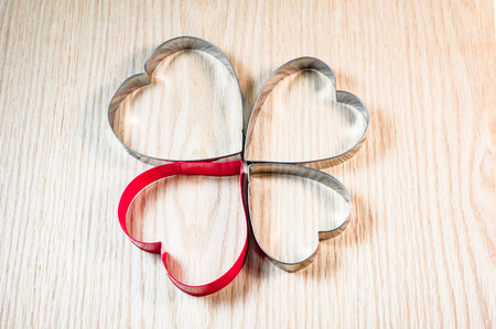 cookie cutters: Cookie cutters,heart shape on the wooden background