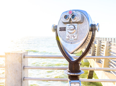 Coin Binoculars on the top over the beach view Editorial