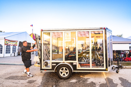 Clearwater,FL-FEB 19,2017;An Undentified man closes the motorcycle trailer doors,on the Florida Motorcycle Expo and Bike Builder Invitational at 49th St.N.,Clearwater FL-Feb19th,2017