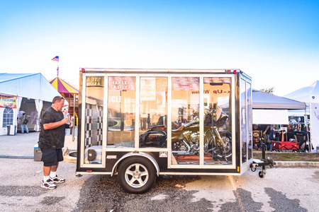 Clearwater,FL-FEB 19,2017;An Undentified man closes the motorcycle trailer doors,on the Florida Motorcycle Expo and Bike Builder Invitational at 49th St.N.,Clearwater FL-Feb19th,2017 Redakční
