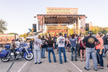 mini bike: Clearwater,FL-FEB 19,2017;Undentified people and bikers gathering at live music performances,on the Florida Motorcycle Expo and Bike Builder Invitational on 49th St.N.,Clearwater FL-Feb19th,2017