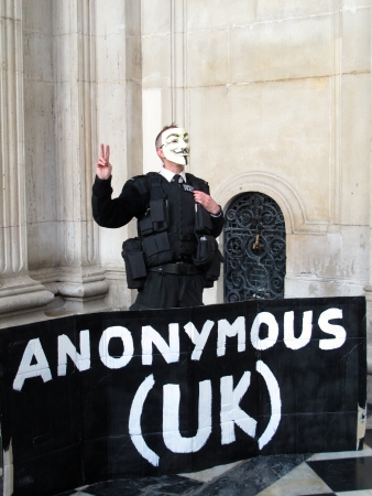 guy fawkes mask: A member of Anonymous at Occupy LSX Stock Photo