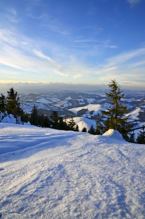 blue cloudy sky: Winter snowy valley view with a blue cloudy sky Stock Photo
