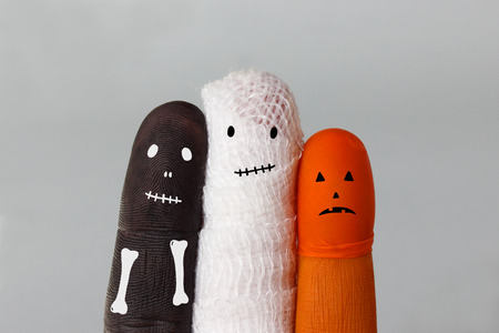 pumkin: Funny halloween characters: Skeleton, Mummy in wrapped cloth and orange painted Pumpkin head - funny finger puppets