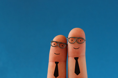 Two smiling business men - succesful teamwork - funny finger people