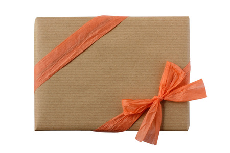 Rectangular gift wrapped in brown kraft paper decorated with peach orange ribbon and bow - isolated on white