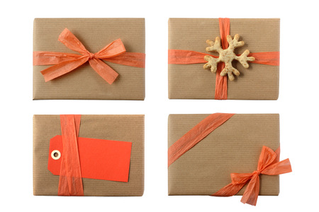 beautifully wrapped: Several christmas presents beautifully wrapped and decorated with peach rose colored ribbons, bows and gift tag with space for your text - isolated on white Stock Photo