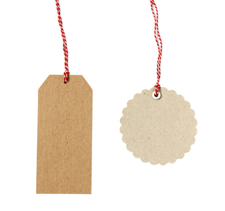 twine: Blank hanging gift tags made from brown eco-friendly kraft paper in different shapes with red twine - isolated on white background