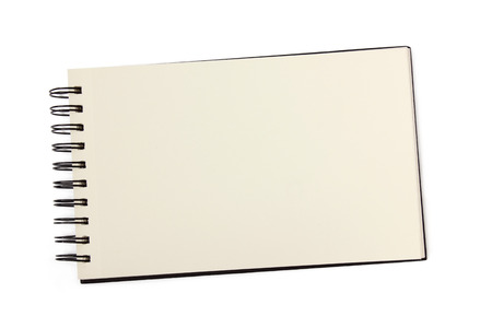 Blank spiral bound sketchbook with empty open page - top view isolated on white photo