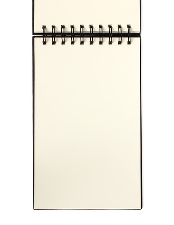 Open spiral bound note book  sketch book with vertical blank page for lists or text - isolated on white background photo