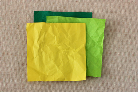 Yellow blank paper note pile photo