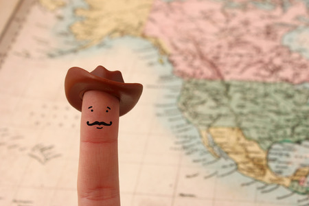 Funny cowboy finger figure with beard Stock Photo