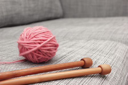 wools: Closeup of pink wool ball and knitting needles old