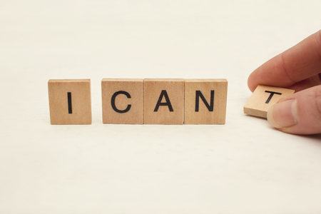 i t: I can self motivation - removing the letter t of the word I cant so it says I can Stock Photo