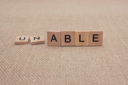 able: Positive motivation concept: Changing the word unable into able